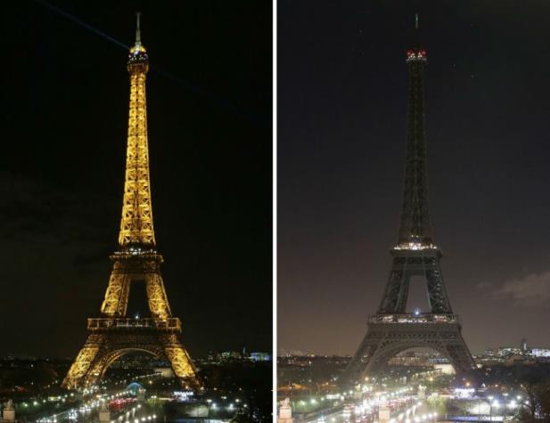 Torre Eiffel as escuras em memória das vítimas dos atentados. Comoção nacional e união superam o medo na França (Jacques Demarthon/AFP/CP)