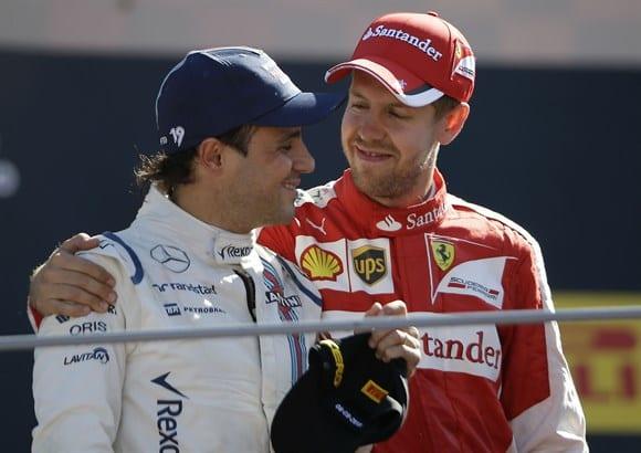 Massa (de branco) contou com a sorte para subir ao pódio em Monza. Vettel teve um gosto a mais de celebrar junto dos tifosi pela primeira vez (AP)